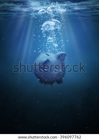 Crisis concept, drowning piggy bank with copy space - stock photo