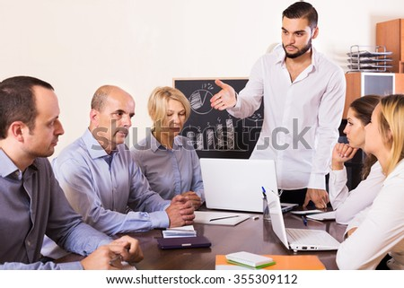 Crisis hits the company: negative business team in office  - stock photo