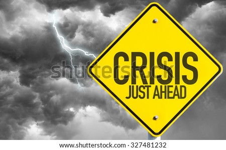Crisis Just Ahead sign with a bad day - stock photo