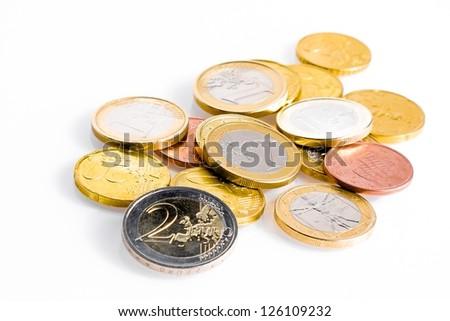 crisis of euro-zone, some euro coins on white background - stock photo