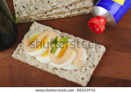 Crispbread with egg and roe spread - stock photo