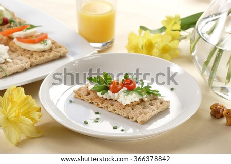 crispbread with tomatoes, parsley and cottage cheese - stock photo