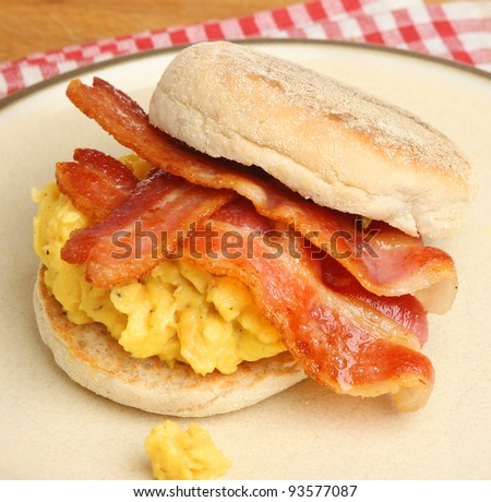 Crispy bacon and scrambled eggs in a toasted muffin
