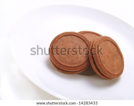Crispy biscuits on a white plate - stock photo