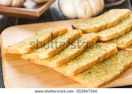 crispy bread garlic on wood background