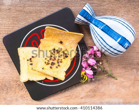 Crispy breads on plate and wooden background