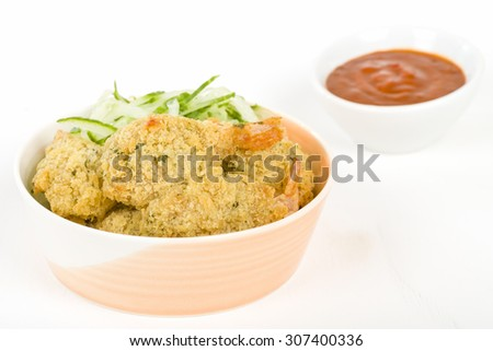 Crispy Butterfly Prawns - Garlic filled prawns, breaded and deep fried. Served with chilli sauce dip. - stock photo