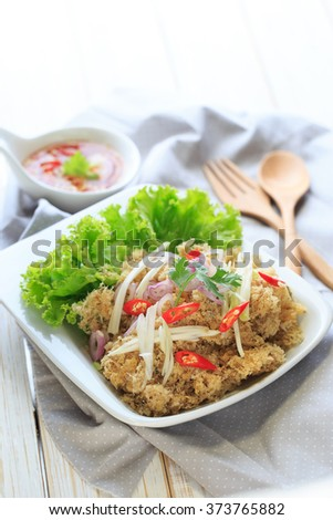 Crispy catfish salad with green mango