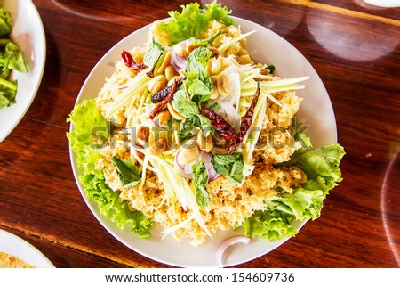 Crispy catfish salad with green mango and vegetable - stock photo