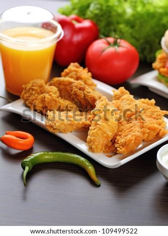 Crispy chicken and juice. - stock photo