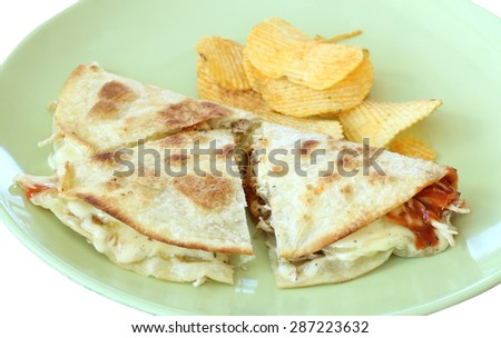 Crispy chicken pie on green plate. - stock photo