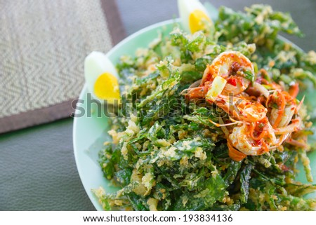 Crispy deep fried morning glory with spicy seafood salad - stock photo