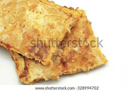 Crispy Empanada Gallega, traditional pie typical from Galicia on a white background - stock photo