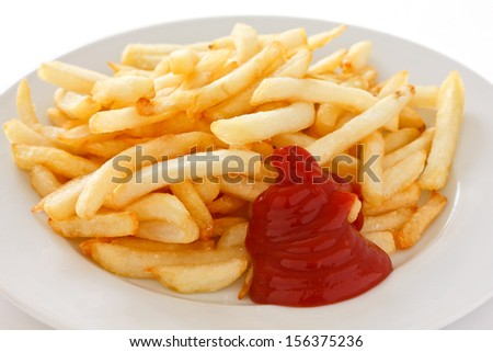 Crispy French fries with ketchup ready to eat - stock photo