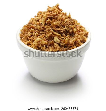 crispy fried onion flakes on white background - stock photo