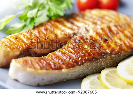 crispy grilled salmon steak with cherry tomatoes and parsley