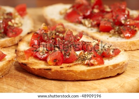 crispy italian bruschetta with basil, garlic and tomato - stock photo