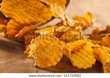 Crispy Orange Sweet Potato Chips with sea salt - stock photo