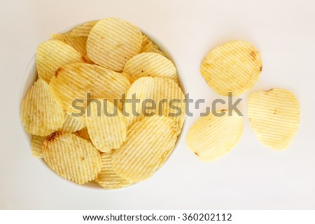 crispy potato chips junk food unhealthy food on bowl white background