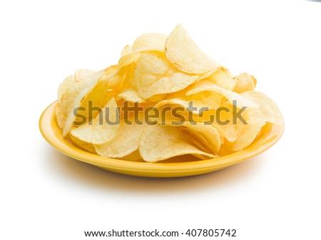 Crispy potato chips on a plate - stock photo