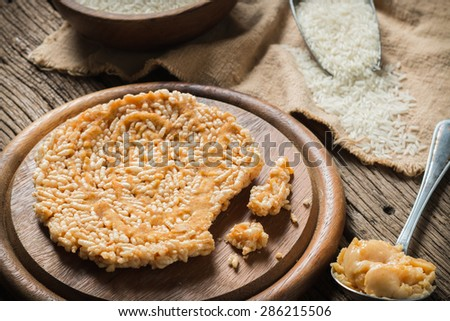 Crispy rice with topping coconut sugar sauce - stock photo
