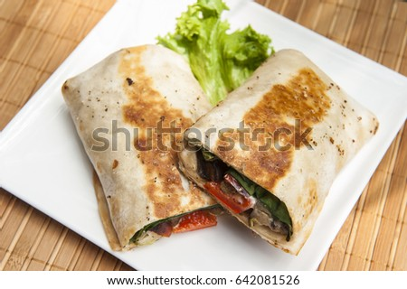 Crispy vegetarian burrito filled with grilled vegetables