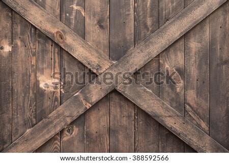 criss-cross wood wall texture - stock photo