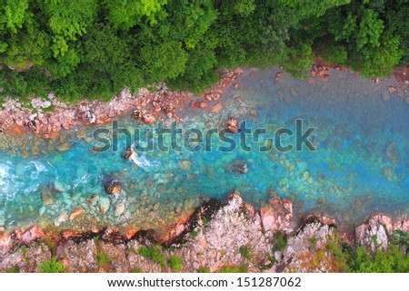 Cristal clear water flowing at the bottom of a canyon - stock photo