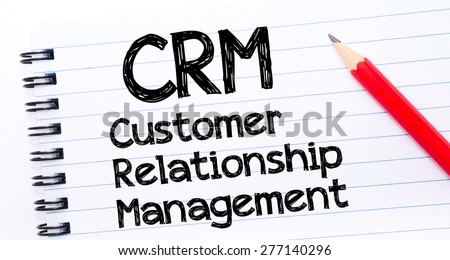 CRM acronym as Customer Relationship Management Text written on notebook page, red pencil on the right. Concept image