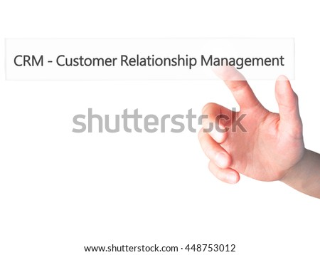 CRM Customer Relationship Management - Hand pressing a button on blurred background concept . Business, technology, internet concept. Stock Photo