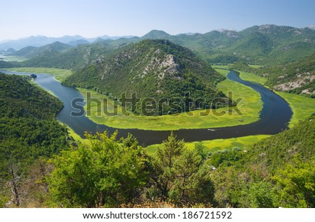 Crnojevica River flowing curved into Skadar Lake National Park, Montenegro - stock photo