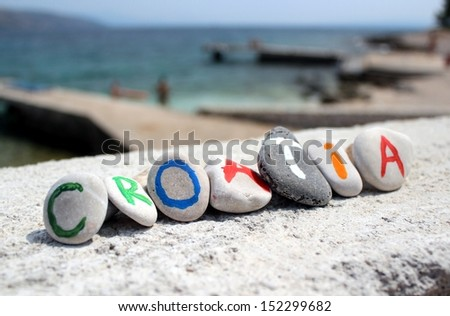 Croatia inscription on the stones with adriatic sea in the background - vacation photo - stock photo