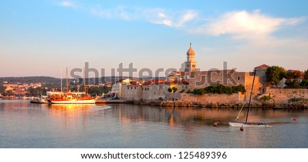Croatia - Krk - Panoramic view of port and city walls from the sea - stock photo
