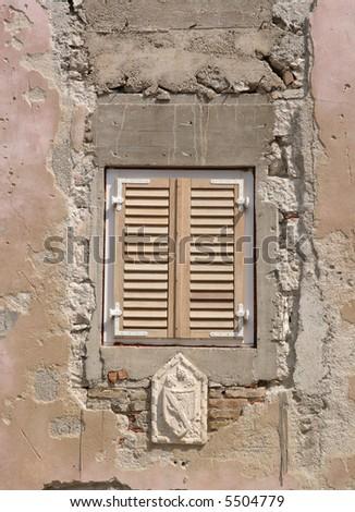 Croatia Rab town - old wall, new shutters - stock photo
