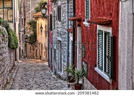 Croatia - Rovinj on Istria peninsula. Old town cobbled street. - stock photo