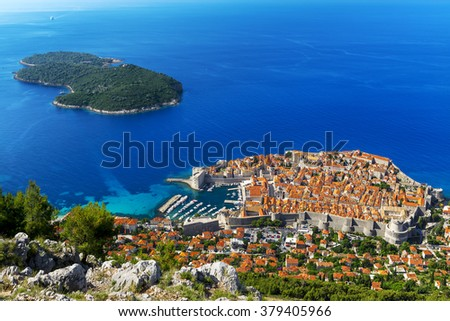 Croatia. South Dalmatia. Aerial view of Dubrovnik, medieval walled city (it is on UNESCO World Heritage List since 1979) and Lokrum Island (nature reserve) - stock photo