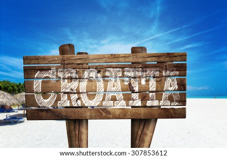 Croatia wooden sign on the beach - stock photo