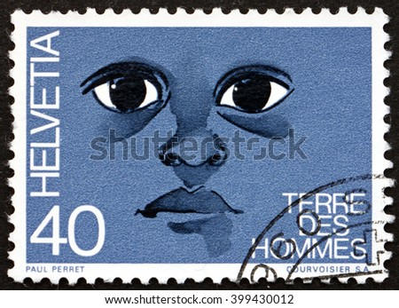 CROATIA ZAGREB, 7 FEBRUARY 2016: a stamp printed in the Switzerland dedicated to Terre des Hommes, Childrens Aid Program, circa 1973 - stock photo