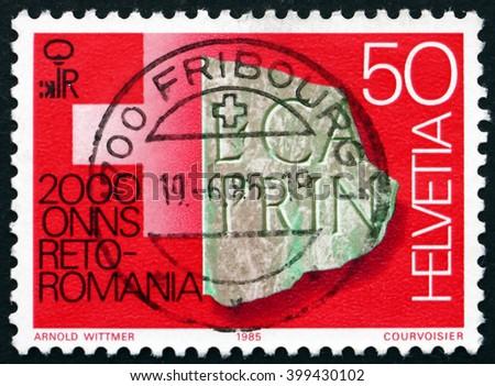 CROATIA ZAGREB, 7 FEBRUARY 2016: a stamp printed in the Switzerland shows Engraved Artifact, Chur, Rheto-Roman Culture Bimillenium, circa 1985 - stock photo