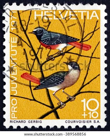 CROATIA ZAGREB, 7 FEBRUARY 2016: a stamp printed in the Switzerland shows European Redstart, Phoenicurus Phoenicurus, Small Passerine Bird, circa 1971 - stock photo