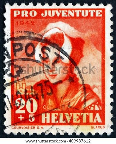 CROATIA ZAGREB, 21 FEBRUARY 2016: a stamp printed in the Switzerland shows Girl of Glarus, circa 1942 - stock photo