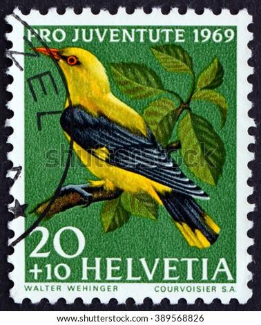 CROATIA ZAGREB, 7 FEBRUARY 2016: a stamp printed in the Switzerland shows Golden Oriole, Oriolus Oriolus, Passerine Bird, circa 1969 - stock photo