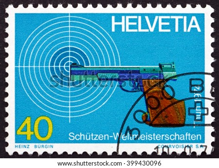 CROATIA ZAGREB, 7 FEBRUARY 2016: a stamp printed in the Switzerland shows Target and Pistol, World Marksmanship Championships, Thun and Bern, circa 1974 - stock photo
