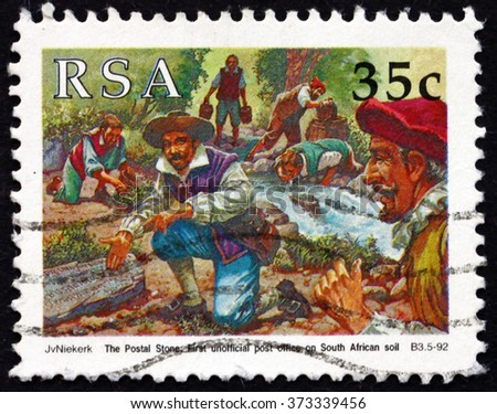 CROATIA ZAGREB, 30 JANUARY 2016: a stamp printed in South Africa dedicated to Postal Stone, Sailors Discovering Postal Stone near Versse River, circa 1992 - stock photo