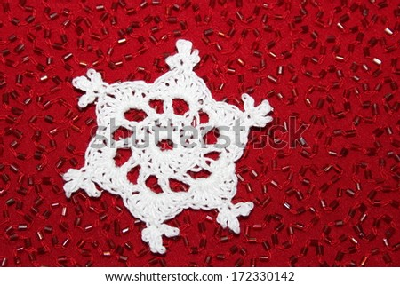 Crochet Snowflake with Red Bead Background - stock photo