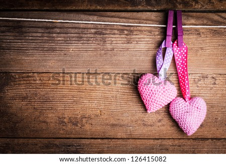 Crochet valentine hearts handing on the rope. Valentine's day greeting card. Love concept - stock photo