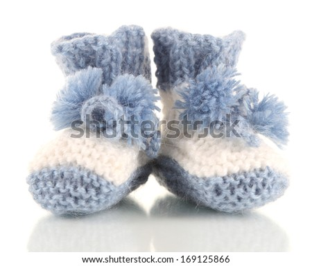 Crocheted booties for baby, isolated on white - stock photo