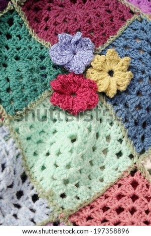 Crochet Patterns Yellow : Crocheted pink, yellow and lilac flowers on a patchwork crochet afghan ...
