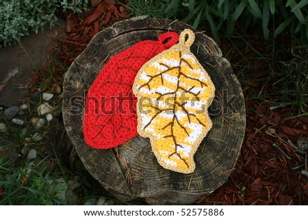 Crocheted potholders shaped like leaves - stock photo