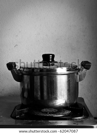 Crock on the gas stove over white background - stock photo